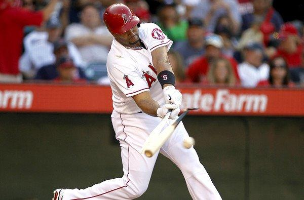 Angels designated hitter Albert Pujols breaks his bat on what proved to be a run-scoring single against the Yankees in the third inning Saturday at Angel Stadium.
