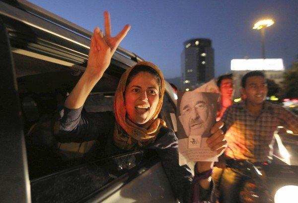 A woman in Tehran's Vanak Square celebrates the victory of Hassan Rowhani in Iran's presidential election. By winning more than half the vote, Rowhani avoided a runoff election.