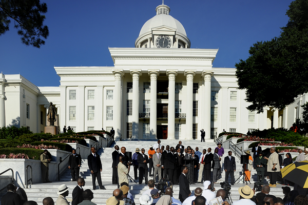 Nation of Islam leader Louis Farrakhan, second from left, speaks in Montgomery, Ala., at an event urging the U.S. Supreme Court to uphold a major portion of the civil-rights-era Voting Rights Act.