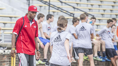 Track & Field: Olympian Walter Davis enjoys helping kids