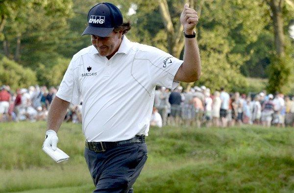 Phil Mickelson reacts to the gallery after making a birdie putt at No. 17 on Saturday during the third round of the U.S. Open at Merion Golf Club.