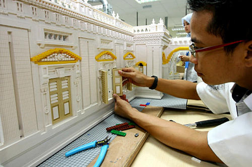 A Legoland Malaysia model builder works on the Sultan Abu Bakar state mosque, which took more than six weeks to complete.