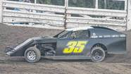 NASCAR driver David Stremme competes in a dirt track modified race at Plymouth Speedway.
