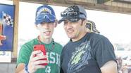 NASCAR driver David Stremme, right, takes a photo with fan Connor Aker, 16, of Plymouth, before competing in a dirt track modified race at Plymouth Speedway on Saturday.