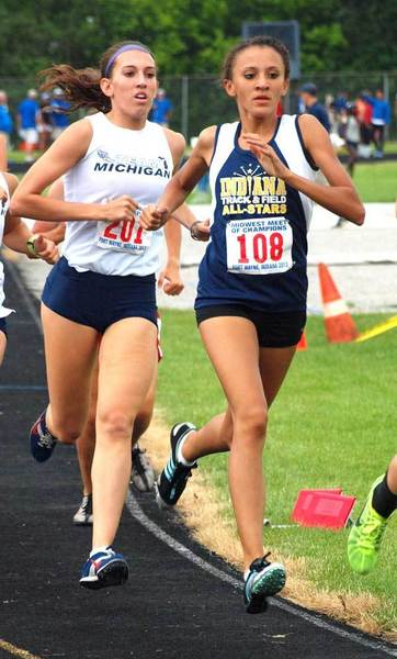 Clay graduate and Indiana All-Star Amanda Farrough (108) leads Michigan's Erin Billete (201) midway through the women's 1600-meter run during Saturday's Midwest Meet of Champions in Fort Wayne.