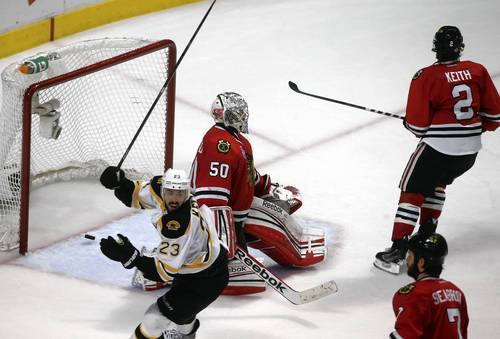 Corey Crawford reacts after letting in the game-winning goal in overtime on Saturday night.