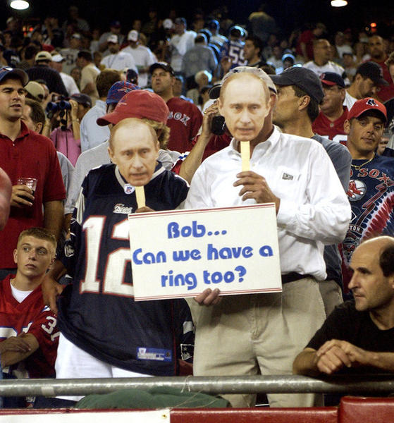 Two fans parody the Super Bowl Ring incident between Patriots owner Robert Kraft and Russian President Vladimir Putin during the Patriots vs. Raiders game on Sept. 8, 2005.