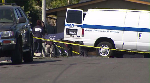 Coroner's officials remove body of woman stabbed to death in West Hills.
