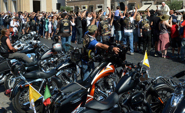 Pope Francis (at top right) blesses Harley-Davidson bikers on Sunday before a Mass at the Vatican. Harley-Davidson riders arrived in Rome to celebrate the motorcycle brand's 110th anniversary.