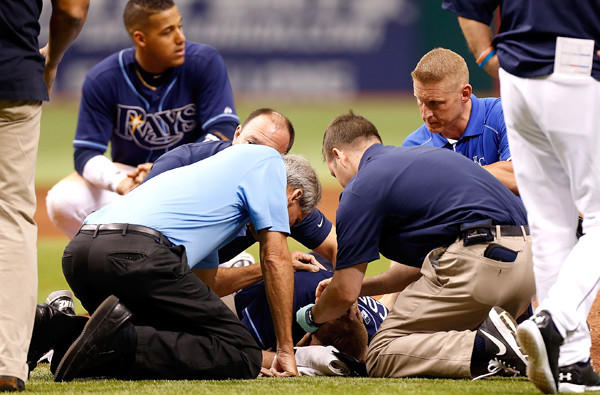 Medical staffers tend to Rays pitcher Alex Cobb after he was hit in the head by a line drive during a game against the Royals on Saturday.