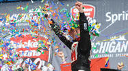 BROOKLYN, Mich. -- Greg Biffle took the checkered flag and the win in the Quicken Loans 400 NASCAR Sprint Cup Series race at Michigan International Speedway on Sunday and made history for manufacturer Ford.