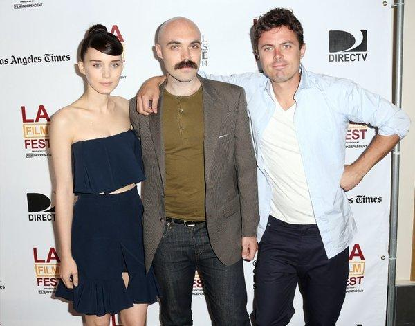 "Actress Rooney Mara, writer-director David Lowery, center, and actor Casey Affleck attend a screening of ""Ain't Them Bodies Saints"" at the Los Angeles Film Festival."