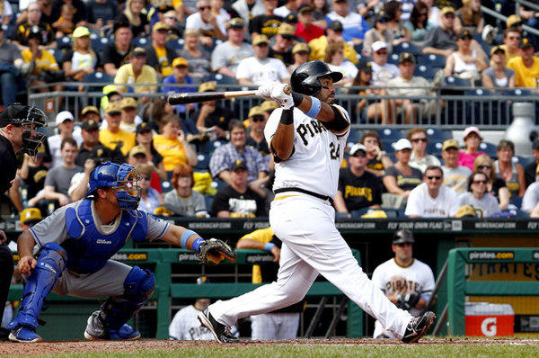 Pittsburgh Pirates' Pedro Alvarez hits a three-run home run in the fifth inning against the Dodgers.