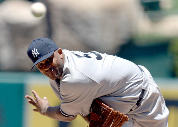 New York Yankees' CC Sabathia delivers against the Angels in the second inning at Angel Stadium.