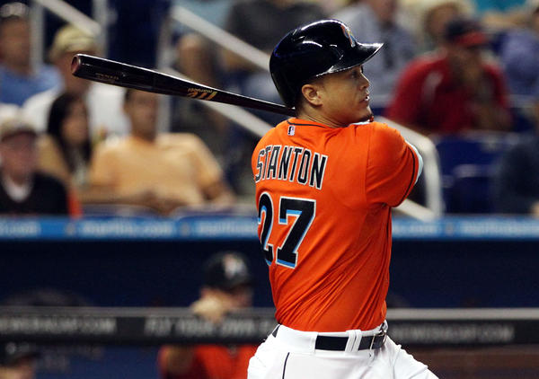 MIAMI, FL - JUNE 16: Giancarlo Stanton #27 of the Miami Marlins hits a double against the St. Louis Cardinals during the first inning at Marlins Park on June 16, 2013 in Miami, Florida. (Photo by Marc Serota/Getty Images) ORG XMIT: 163494122
