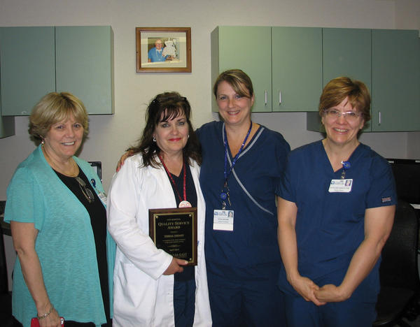 Teresa Dienst, RN, second from left, Berkeley Medical Center's April Quality Service Award winner, receives her award from Donna Clews, vice president of patient-care services/chief nursing officer, left; Rosa Brown, RN, second from right; and Kathleen Kerstetter, RN, fifth-floor nurse director.