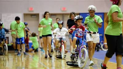 Children, adults with disabilities learn to ride at iCan Bike camp