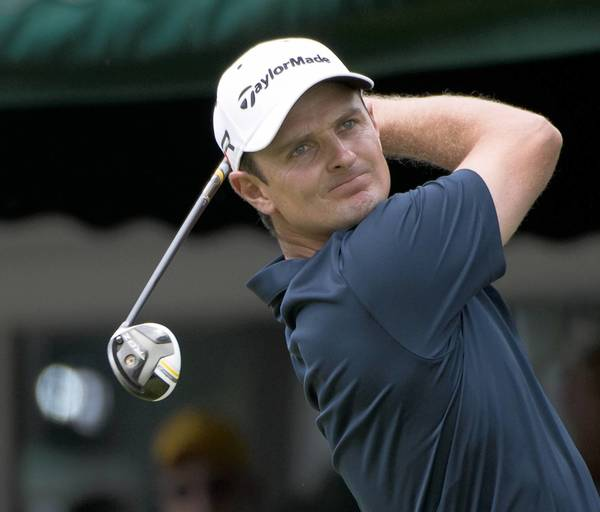 Justin Rose tees off on the first hole during the final round of The U.S. Open at Merion Golf Club in Ardmore on Sunday.