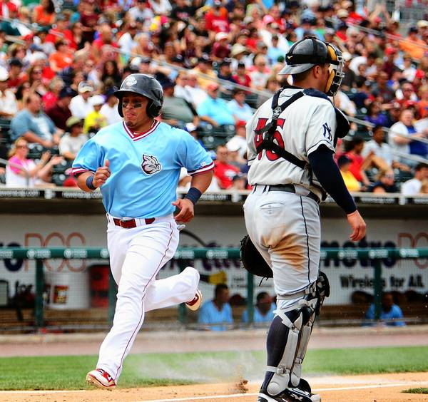 The IronPigs' Carlos Ruiz scores a run against Scranton in the fourth inning.