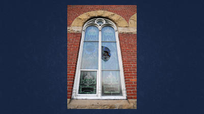 This 19th Century window at Christ Casebeer Evangelical Lutheran Church in Lincoln Township was broken by a vandal Saturday.