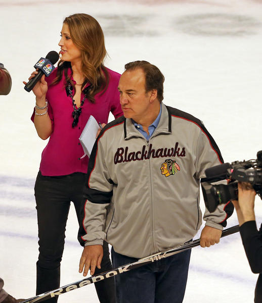 "Susannah Collins, formerly of Comcast Sports Network, gets ready to take part in the ""Shoot the Puck promotion"" with Jim Belushi."