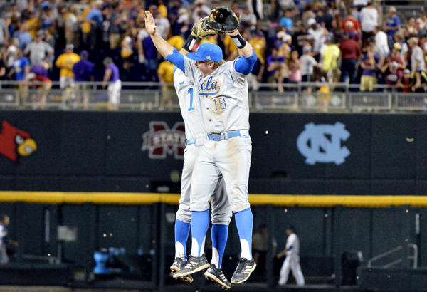 UCLA's Pat Valaika, left, and Cody Regis celebrate after the last out against LSU.