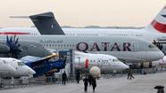 PARIS (Reuters) - Big finance waded into a rain-soaked Paris Airshow with more than $10 billion in orders for jumbo passenger jets as planemakers dueled over strategy for large aircraft on Monday.