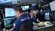 Wall St. rises in volatile session before Fed meeting
