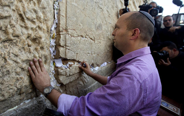 "In this file photo, Naftali Bennett, head of the Jewish Home party, touches the stones of the Western Wall, the holiest site where Jews can pray in Jerusalem's Old City. The idea of Palestinians establishing a state has ""reached a dead end,"" Bennett said Monday."