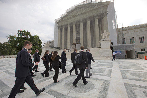 Law students visiting from Liberty University in Lynchburg, Va., arrive at the Supreme Court in Washington.
