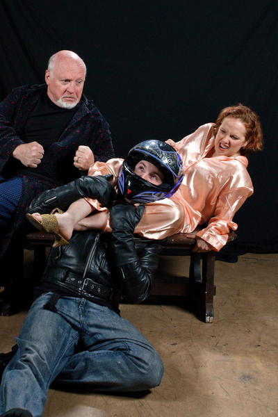 "Heather Bagnall, Eric Hufford (in motorcycle helmet) and Ken Sabel appear in ""Taking Steps,"" a farce by Alan Ayckbourn running through June 29 at Colonial Players."
