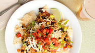 Nobody will miss the meat in this colorful, zesty vegetarian taco salad. The rice and bean mixture can be made ahead and the salad quickly assembled at mealtime.