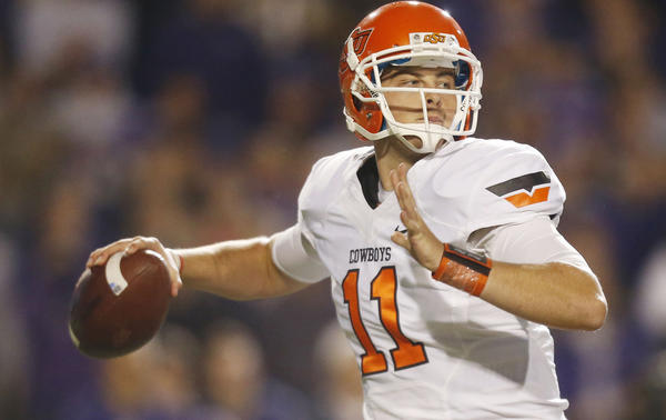 Oklahoma State quarterback Wes Lunt looks for a receiver against Kansas State last November.