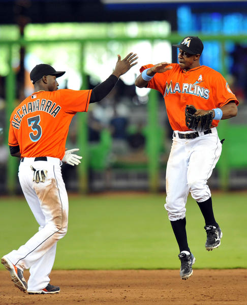 Jun 16, 2013; Miami, FL, USA; Miami Marlins left fielder Juan Pierre (right) celebrates their 7-2 win with shortstop Adeiny Hechavarria (3) against the St. Louis Cardinals at Marlins Park. Mandatory Credit: Steve Mitchell-USA TODAY Sports ORG XMIT: USATSI-122386