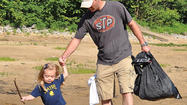About 90 people took to the shores of the Fort Boonesborough State Park beach for the 21st annual River Sweep Saturday.