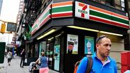 Federal agents raided 7-Eleven stores across the East Coast on Monday after prosecutors revealed felony indictments accusing franchise owners of operating an immigrant-exploitation scheme from at least 14 of their convenience stores for more than a decade.