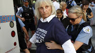 Twenty-two environmental activists who staged a sit-in to protest the expansion of the Keystone XL Pipeline that would bring crude oil from Canada to the United States were arrested as part of a planned protest this morning outside the State Department offices in the Loop, police said.