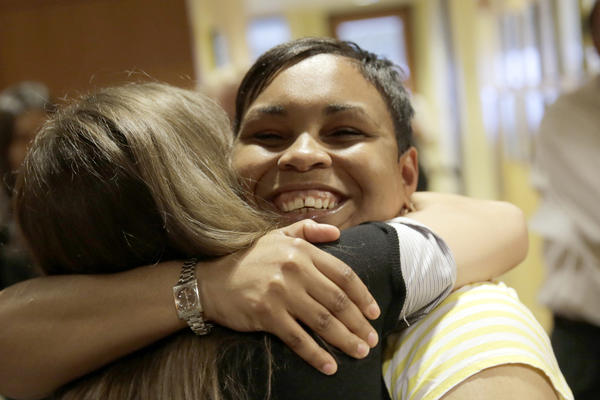 Nicole Harris, who was released from prison after federal court overturned her conviction in the 2005 death of her 4-year-old son, is hugged by Marjorie B. Moss, left, after learning the Cook County State's Attorney dropped the charges.