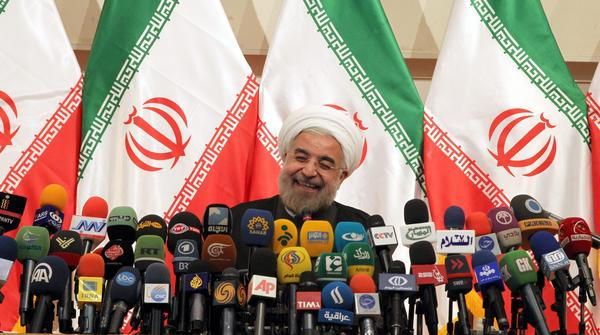 Iran's president-elect, Hassan Rowhani, reacts during a news conference in Tehran.
