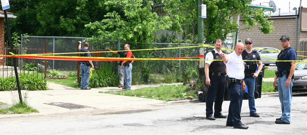 Chicago police investigate a shooting at 11000 block of South Ashland Ave. in the city's Morgan Park neighborhood.