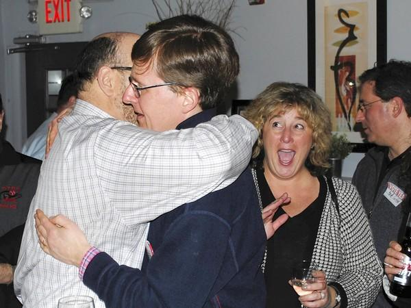 Dan Jenks, co-chairman of Community Leaders Educating and Advocating for the 113 Referendum, gets a hug from Tripp Hainsfurther on April 9, 2013, after declaring a victory for the $89 million bond referendum in Township High School District 113.