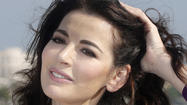 Nigella Lawson: Photos show hubby's hands on her neck during row