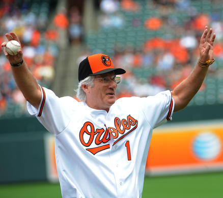 Actor Richard Gere threw out the first pitch before the Orioles faced the Red Sox on June 16, 2013. (The University of Massachusetts alum was wearing Orioles gear.)