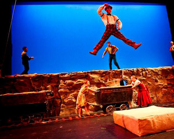 With a trampoline cleverly hidden inside a rolling iron ore car, Cirque Mechanics acrobats perform flying flips, twists and splits.