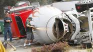 Cement truck tips over on Bluebird Canyon, driver injured
