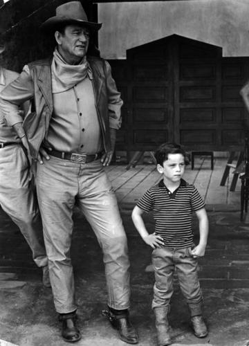 "1967: John Wayne, with his son, on location in Mexico for the filming of ""The War Wagon."""