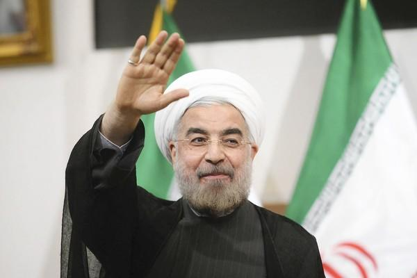 Iranian President-elect Hassan Rohani gestures to the media during a news conference in Tehran.