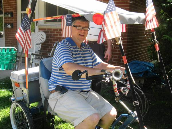 Keith Grogan has ridden his four-wheel bike in Wheaton parades.