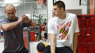 Except for the fact that his left foot is encased in a protective boot, and that most of his training is done sitting down, little has changed for former Maryland center Alex Len as he gets ready for next week's NBA draft.