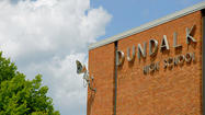 A labor group is alleging that a supervisor with an asbestos abatement contractor at Dundalk High School pressured workers to drink alcohol on the job and violated safety standards.
